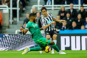 Adrian Mariappa (#6) of Watford slides in to block the cross attempt from Yoshinori Muto (#13) of Newcastle United during the Premier League match between Newcastle United and Watford at St. James's Park, Newcastle, England on 3 November 2018.