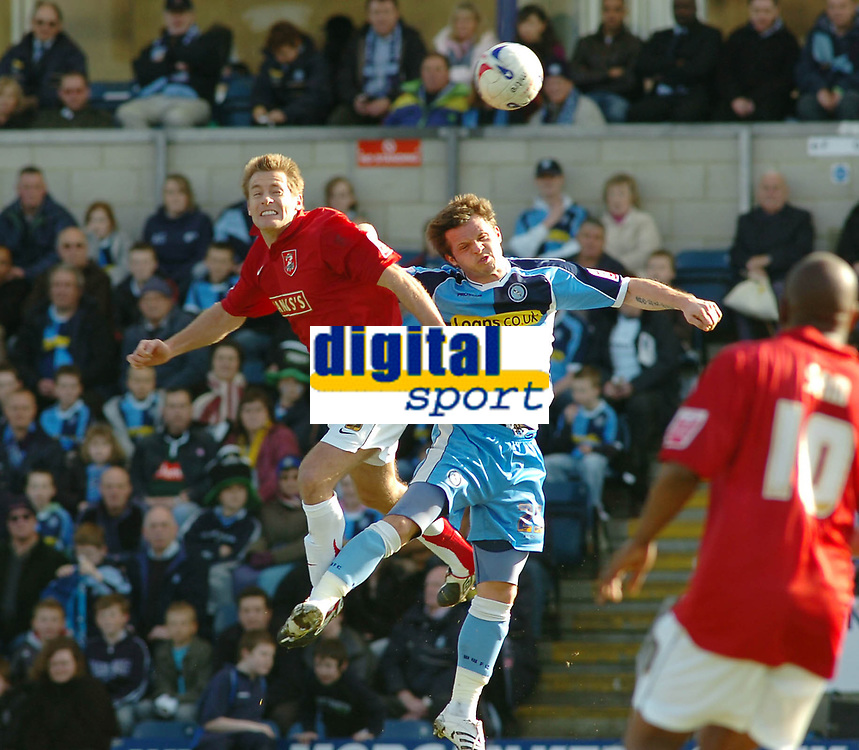Photo: Kevin Poolman.<br />Wycombe Wanderers v Walsall. Coca Cola League 2. 17/03/2007. Martin Butler of Walsall (left) gets his head to the ball before Sam Stockley of Wycombe.