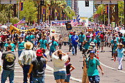 May 29 - PHOENIX, AZ: Pro-immigrant marchers approach the Arizona State Capitol. More than 30,000 people, supporters of immigrants' rights and opposed to Arizona SB1070, marched through central Phoenix to the Arizona State Capitol Saturday. SB1070 makes it an Arizona state crime to be in the US illegally and requires that immigrants carry papers with them at all times and present to law enforcement when asked to. Critics of the law say it will lead to racial profiling, harassment of Hispanics and usurps the federal role in immigration enforcement. Supporters of the law say it merely brings Arizona law into line with existing federal laws.  Photo by Jack Kurtz / ZUMA Press