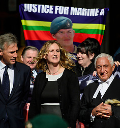 © Licensed to London News Pictures.15/03/2017.London, UK.  CLAIRE BLACKMAN, wife of Sergeant Alexander Blackman, cposes for a photograph with former Royal Marines as she leaves the Royal Courts of Justice in London, where a judge reduced the conviction of Sgt Blackman from Murder to Manslaughter, on appeal.  Also known as Marine A, Sgt Blackman was appealing a life sentence for the murder of a wounded Taliban fighter in Afghanistan in 2011.Photo credit: Ben Cawthra/LNP