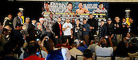 Dec 12,2012. Los Angeles CA. USA.. Amir Khan(L) poses with Carlos Molina(R.) with all the other fighters during a Los Angeles press conference. The fight will be scene on ShowTime live from the Los Angeles Sports Arena. Photo by Gene Blevins/LA Daily News