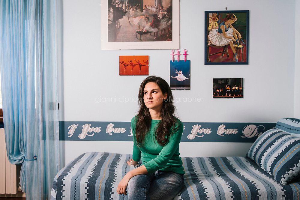 NAPLES, ITALY - 26 MAY 2018: Giada Gramanzini, a 29-year-old unemployed university graduate who moved back in with her retired parents, poses for a portrait in her childhood bedroom in Naples, Italy, on May 26th 2018.<br /> <br /> Credit: Gianni Cipriano for The Wall Street Journal<br /> <br /> Slug: GENDIVIDE<br /> <br /> Giada Gramanzini hasn&rsquo;t found a job since deciding last year not to renew a three-month contract as a fulltime receptionist that paid her 400 euros a month, or about $2.80 an hour. She sent out about 70 resumes in the past six months in search of a job where she can put her degree in foreign languages to work.<br /> <br /> The Italian economy last year grew at its fastest rate since 2010, but the improvement hasn&rsquo;t trickled down to millions of people in their 20s and 30s, leaving a yawning generation gap with their baby boomer parents.<br /> <br /> Giada Gramanzini hasn&rsquo;t found a job since deciding last year not to renew a three-month contract as a fulltime receptionist that paid her 400 euros a month, or about $2.80 an hour. She sent out about 70 resumes in the past six months in search of a job where she can put her degree in foreign languages to work.<br /> <br /> The Italian economy last year grew at its fastest rate since 2010, but the improvement hasn&rsquo;t trickled down to millions of people in their 20s and 30s, leaving a yawning generation gap with their baby boomer parents.
