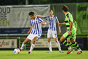 Cheltehham Town's Josh Thomas plays a pass during the Gloucestershire Senior Cup match between Forest Green Rovers and Cheltenham Town at the New Lawn, Forest Green, United Kingdom on 20 September 2016. Photo by Shane Healey.