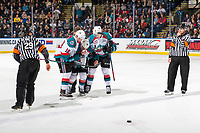 KELOWNA, CANADA - JANUARY 26: Ethan Ernst #19 and Cayde Augustine #5 assist Liam Kindree #26 of the Kelowna Rockets off the ice after an initial assessment by  athletic therapist Scott Hoyer on the ice after colliding with a player against the Vancouver Giants on January 26, 2019 at Prospera Place in Kelowna, British Columbia, Canada.  (Photo by Marissa Baecker/Shoot the Breeze)