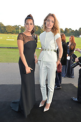 Left to right, PRINCESS TAMARA CZARTORYSKI and NATALIA VODIANOVA at the Chovgan Twilight Polo Gala in association with the PNN Group held at Ham Polo Club, Petersham Close, Richmond, Surrey on 10th September 2014.