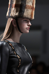 © Licensed to London News Pictures. 14 February 2014, London, England, UK. A model walks the runway at the DAKS catwalk show during London Fashion Week AW14 at the BFC Courtyard Show Space/Somerset House. Photo credit: Bettina Strenske/LNP