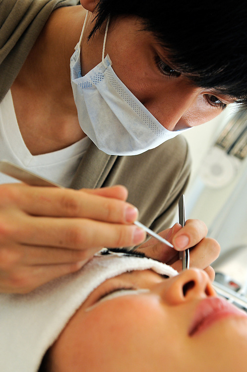 At Twiggy beauty salon Ning Chao with eyerist Yuuki Takahashi working on a lash extension
