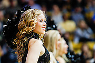 November 13th, 2013:  A Colorado Buffaloes cheerleader cheers during the NCAA Basketball game between the University of Wyoming Cowboys and the University of Colorado Buffaloes at the Coors Events Center in Boulder, Colorado