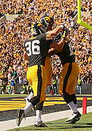 September 21 2013: Iowa Hawkeyes linebacker Cole Fisher (36), Iowa Hawkeyes wide receiver Riley McCarron (83) and Iowa Hawkeyes wide receiver Kevonte Martin-Manley (11) celebrate after Martin-Manley's 63 yard punt return for a touchdown during the second quarter of the NCAA football game between the Western Michigan Broncos and the Iowa Hawkeyes at Kinnick Stadium in Iowa City, Iowa on September 21, 2013. Iowa defeated Western Michigan 59-3.