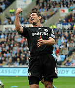 Frank Lampard celebrates Alex's goal during the FA Cup Sponsored by E.ON 6th round match between Coventry City and Chelsea at the Ricoh Arena on March 7, 2009 in Coventry, England.