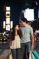 Young Couple Walking on City Street At Nighttimes