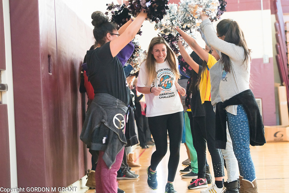 Cara Nelson, a 7th grade social studies teacher at the East Hampton Middle School, is introduced during a sendoff in her honor, at the school in East Hampton, Jan. 18, 2018. Nelson will leave next week to participate in a trip where she will run seven marathons in seven days on seven continents.