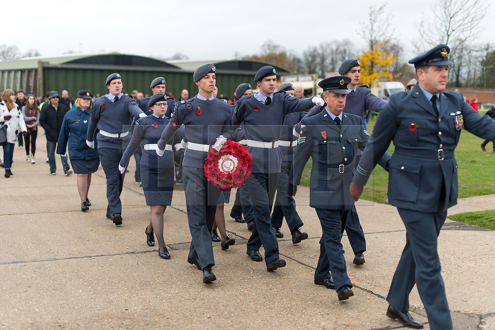 © Licensed to London News Pictures. 08/11/2015. Duxford, UK. Air cadets march before an official service of Remembrance and wreath laying ceremony at Imperial War Museum Duxford, Cambridgeshire on Remembrance Sunday 2015. . Photo credit: Ben Cawthra/LNP