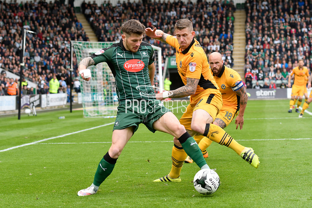 Matthew Kennedy (16) of Plymouth Argyle battles for possession with Scot Bennett of (17) Newport County during the EFL Sky Bet League 2 match between Plymouth Argyle and Newport County at Home Park, Plymouth, England on 17 April 2017. Photo by Graham Hunt.