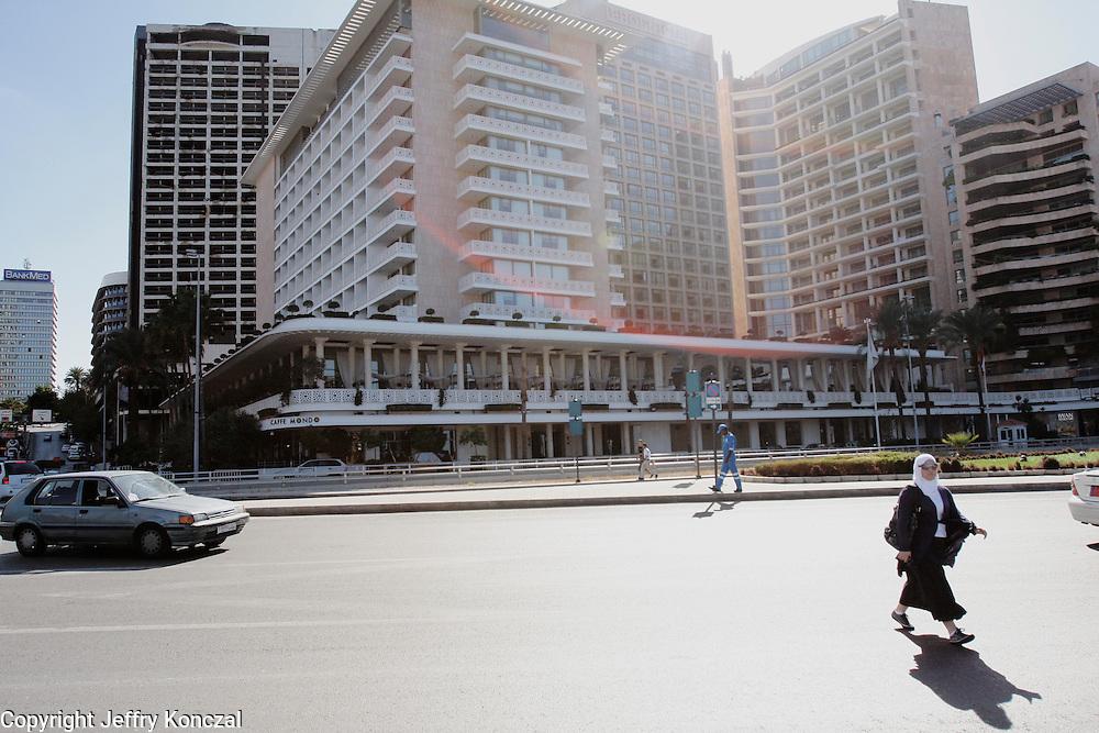 A women walks across the street in Beirut, Lebanon.