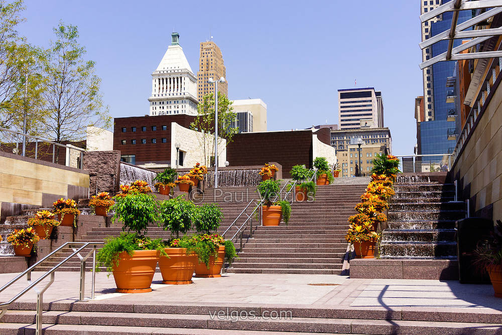Photo of Cincinnati downtown central business district buildings, flowers and stairs along Mehring Way street including PNC building, Carew Tower building, and US Bank building. Photo is high resolution and was taken in 2012.