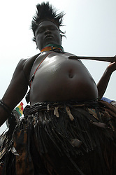 Ghana, Accra, 2007. A traditional dancer from Tamale, in the north of Ghana, makes a ritual display of cutting himself.