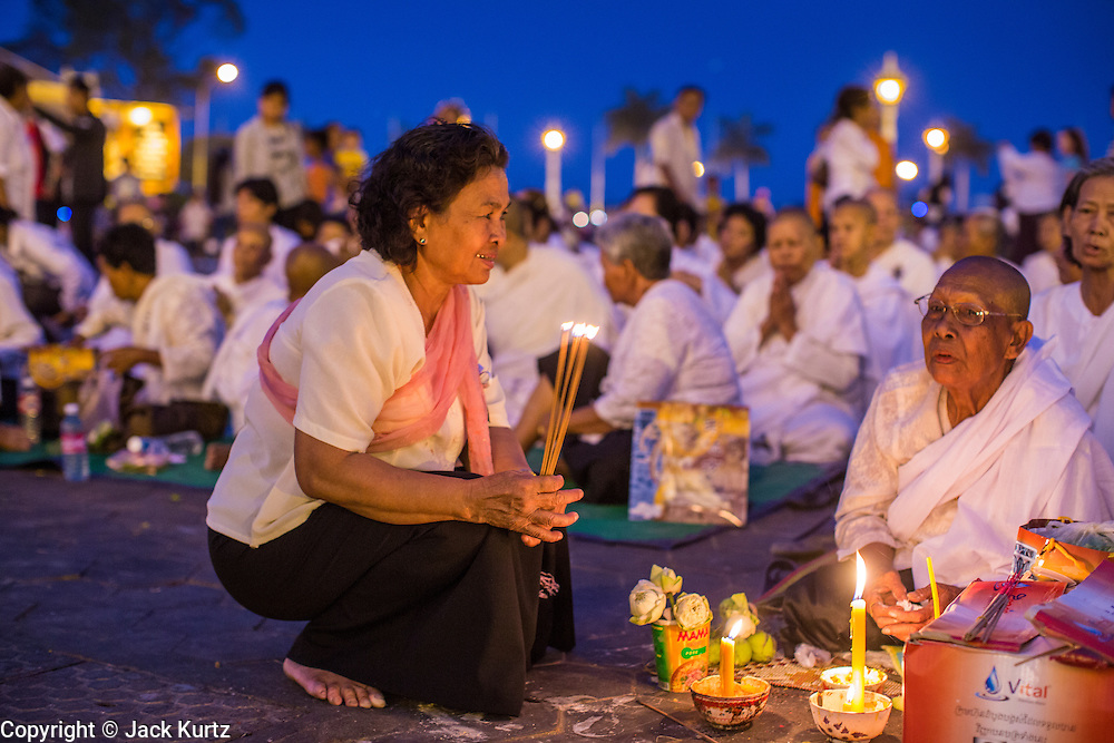 "29 JANUARY 2013 - PHNOM PENH, CAMBODIA:   People gather on the plaza in front of the Royal Palace in Phnom Penh, Cambodia, to mourn for late Cambodian King Norodom Sihanouk. Sihanouk (31 October 1922 - 15 October 2012) was the King of Cambodia from 1941 to 1955 and again from 1993 to 2004. He was the effective ruler of Cambodia from 1953 to 1970. After his second abdication in 2004, he was given the honorific of ""The King-Father of Cambodia."" Sihanouk held so many positions since 1941 that the Guinness Book of World Records identifies him as the politician who has served the world's greatest variety of political offices. These included two terms as king, two as sovereign prince, one as president, two as prime minister, as well as numerous positions as leader of various governments-in-exile. He served as puppet head of state for the Khmer Rouge government in 1975-1976. Most of these positions were only honorific, including the last position as constitutional king of Cambodia. Sihanouk's actual period of effective rule over Cambodia was from 9 November 1953, when Cambodia gained its independence from France, until 18 March 1970, when General Lon Nol and the National Assembly deposed him. Upon his final abdication, the Cambodian throne council appointed Norodom Sihamoni, one of Sihanouk's sons, as the new king. Sihanouk died in Beijing, China, where he was receiving medical care, on Oct. 15, 2012. His cremation is scheduled to take place on Feb. 4, 2013. Over a million people are expected to attend the service.     PHOTO BY JACK KURTZ"
