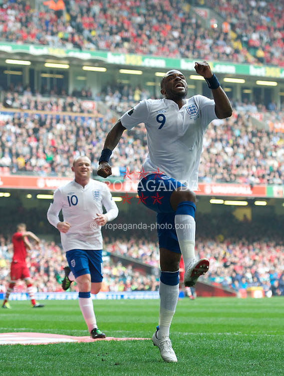 CARDIFF, WALES - Saturday, March 26, 2011: England's Darren Bent celebrates scoring his side's second goal against Wales during the UEFA Euro 2012 qualifying Group G match at the Millenium Stadium. (Photo by Chris Brunskill/Propaganda)