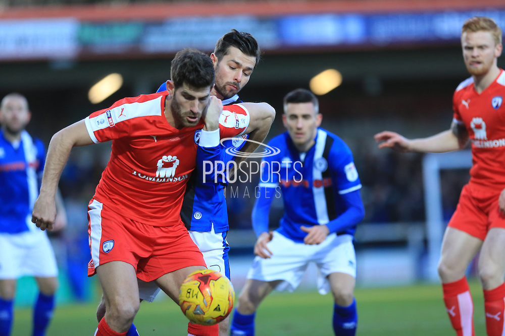 Ched Evans holds off Joe Rafferty during the EFL Sky Bet League 1 match between Rochdale and Chesterfield at Spotland, Rochdale, England on 26 December 2016. Photo by Daniel Youngs.