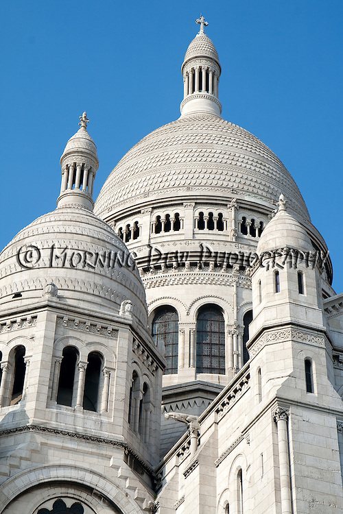 Intricate carvings adorn the domes of Sacre-Coeur Basilica.