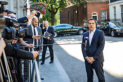 © Licensed to London News Pictures. 26/06/2018. London, UK. Prime Minister of Greece Alexis Tsipras (R) speaks to the press outside 10 Downing Street after meeting with Prime Minister Theresa May. Photo credit: Rob Pinney/LNP