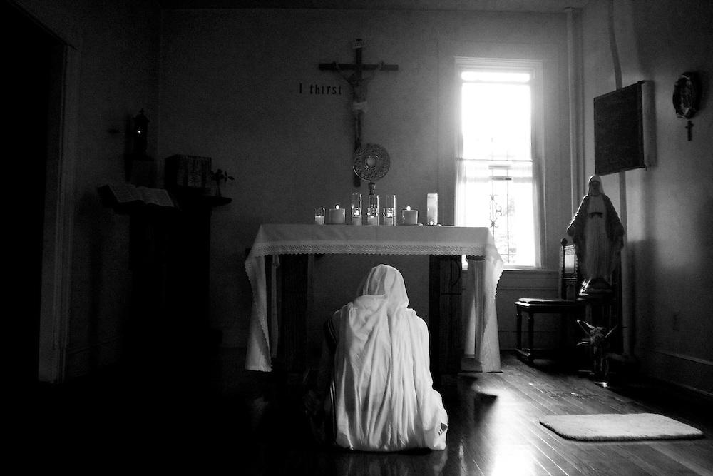 A nun prays in Anacostia.