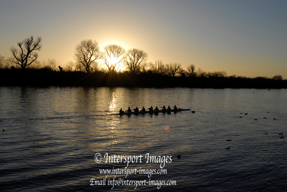 Chiswick,  GREAT BRITAIN,   GVs Barnes and Chiswick area, dawn before the Scullers Head of the River Race.  01/12/2007 [Mandatory Credit Peter Spurrier/Intersport Images]. Chiswick,  GREAT BRITAIN,   GVs Barnes and Chiswick area, dawn before the Scullers Head of the River Race.  01/12/2007 [Mandatory Credit Peter Spurrier/Intersport Images].  Crews crossing the River Thames at Corney Reach, during a gap in the Race. , Rowing Course: River Thames, Championship course, Putney to Mortlake 4.25 Miles, , Sunrise, Sunsets, Silhouettes