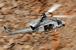 United States Marines Corps Bell UH-1Y Venom (SN 168497) flies low level on the Jedi Transition through Star Wars Canyon / Rainbow Canyon, Death Valley National Park, Panamint Springs, California, United States of America
