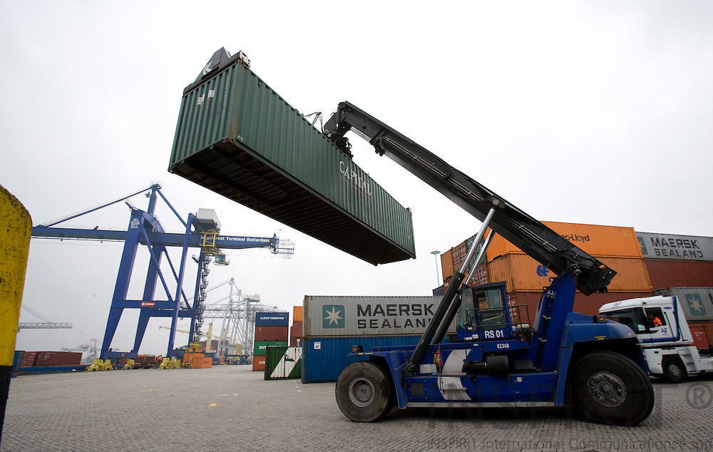 ROTTERDAM - NETHERLAND - 21 FEBRUARY 2008 -- Port of Rotterdam -- Unloaded containers being driven away at the Interforest Terminal Rotterdam.  Photo: Erik Luntang
