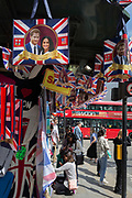 A week before the royal wedding between Prince Harry and Meghan Markle who adorn merchandise hanging from a tourist trinket kiosk in Piccadilly Circus, on 9th May, in London, England.