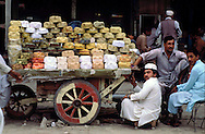 Pakistan  Peshawar  1986..Old City..A  seller of hats in Saddar Bazaar
