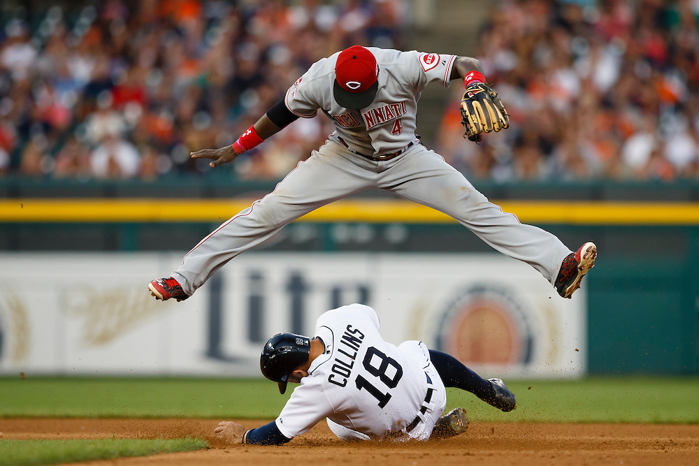 Jun 16, 2015; Detroit, MI, USA; Cincinnati Reds second baseman Brandon Phillips (4) leaps over Detroit Tigers designated hitter Tyler Collins (18) as he slides into second after making a throw to first to complete a double play in the sixth inning at Comerica Park. Mandatory Credit: Rick Osentoski-USA TODAY Sports