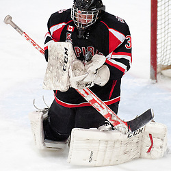 AURORA, ON - Jan 17 : Ontario Junior Hockey League Game Action between Aurora Tigers and Stouffville Spirit.  Tim Bester #33 of the Stouffville Spirit Hockey Club makes the save during third period game action.<br /> (Photo by Phillip Sutherland / OJHL Images)