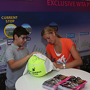 March 9, 2014. Indian Wells, California. Petra Kvitova spends time in the WTA Fan Zone Booth with fans during the 2014 BNP Paribas Open. (Photo by Billie Weiss/BNP Paribas Open)