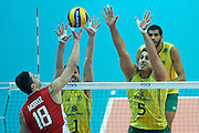 Russia's Pavel Moroz (left) attacks against Brazil's Bruno Mossa Rezende and Sidnei Dos Santos Jr. (right) while volleyball match between Brazil and Russia during the 2014 FIVB Volleyball World Championships at Spodek Hall in Katowice on September 14, 2014.<br /> <br /> Poland, Katowice, September 14, 2014<br /> <br /> For editorial use only. Any commercial or promotional use requires permission.<br /> <br /> Mandatory credit:<br /> Photo by &copy; Adam Nurkiewicz / Mediasport