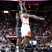 29 January 2012: Miami Heat small forward LeBron James (6) takes a jumpshot over Chicago Bulls shooting guard Ronnie Brewer (11) during the Miami Heat 97-93 victory over the Chicago Bulls at the AmericanAirlines Arena, Miami, Florida, USA.