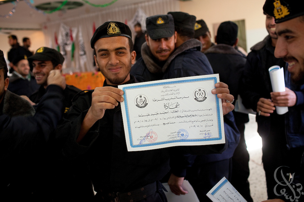 Palestinian HAMAS police graduates of a Marine training program congratulate one another after a December 19, 2009 ceremony near Khan Yunis, Gaza. the HAMAS police force was one of the main targets of the 22 day Israeli offensive a year ago and lost more than 150 members on the first day of strikes alone. The past year has seen HAMAS slowly rebuild its capacity, although the organization is careful not to congregate in large groups and only trains now in small numbers to avoid being an easy target again.