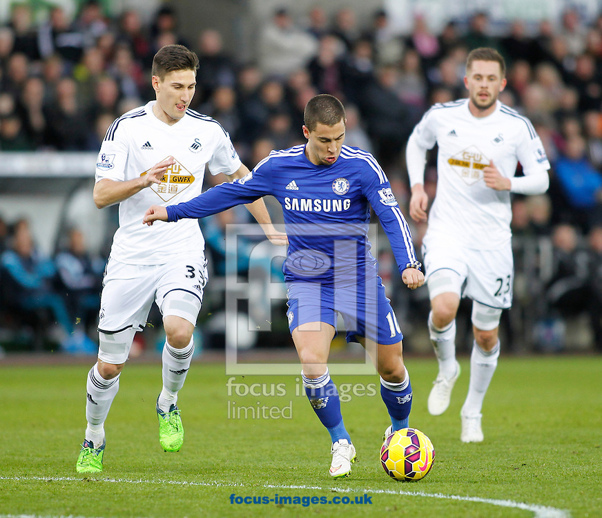 Frederico Fernandes of Swansea City and Eden Hazard of Chelsea during the Barclays Premier League match at the Liberty Stadium, Swansea<br /> Picture by Mike Griffiths/Focus Images Ltd +44 7766 223933<br /> 17/01/2015