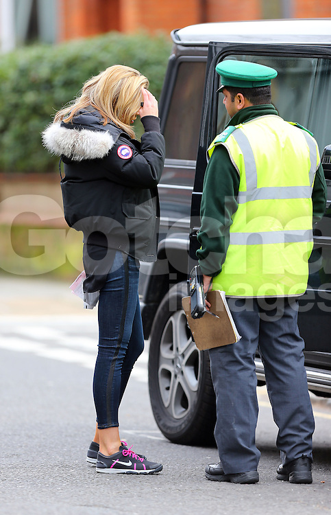 Model Abbey Clancy narrowly escapes her car from being towed in London, UK. 07/03/2014<br />