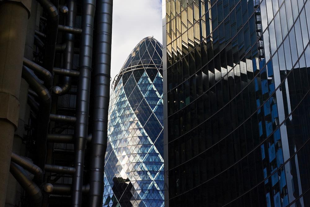 London landmarks Swiss Re Building between The Lloyds Building and The Willis Building, England, UK