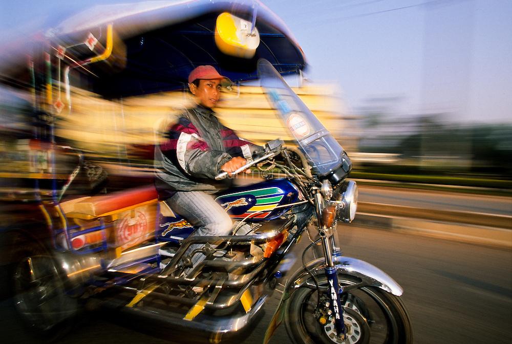 Tuk Tuk taxi driver in Vientiane, Laos