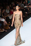 Fleshtone sequined gown with see-through insets. By Monique Lhuillier at Spring 2013 Fall Fashion Week in New York.
