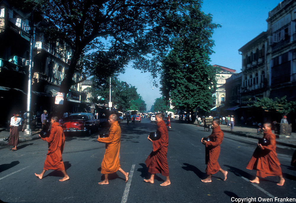 Buddhist monks in line to get their lunch offerings in Yangon (Rangoon), Myanmar (Burma).Photo by Owen Franken.