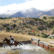 Emma Craig riding Penfold in action at the water jump during the Cross Country event at the Wakatipu One Day Horse Trials at the Pony Club grounds,  Queenstown, Otago, New Zealand. 15th January 2012. Photo Tim Clayton