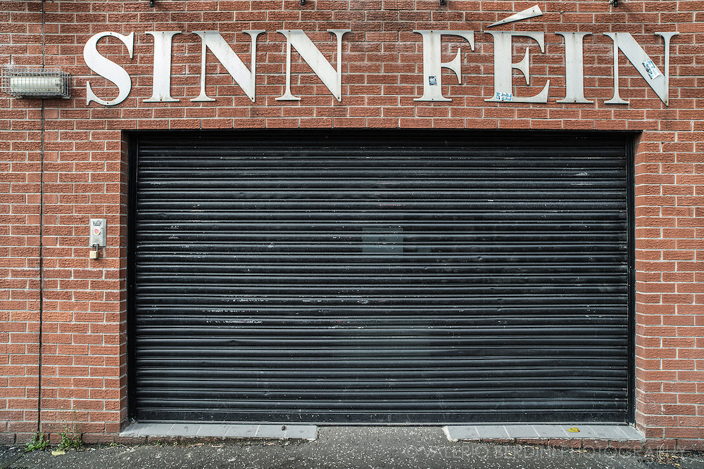 "Sinn Féin head office, The Falls. Belfast. Sinn Féin is an Irish republican political party active in Northern Ireland. Sinn Féin is the largest group in the Republican wing of Irish nationalism and is closely associated with the Provisional IRA, however, the SF leadership has denied these claims. A republican document of the early 1980s states, ""Both Sinn Féin and the IRA play different but converging roles in the war of national liberation. The Irish Republican Army wages an armed campaign... Sinn Féin maintains the propaganda war and is the public and political voice of the movement"""