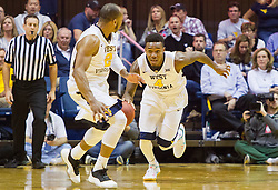 Jan 10, 2017; Morgantown, WV, USA; West Virginia Mountaineers guard Daxter Miles Jr. (4) dribbles the ball up the floor during the second half against the Baylor Bears at WVU Coliseum. Mandatory Credit: Ben Queen-USA TODAY Sports