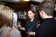 (from left) Jenny Shinkle of LexisNexis, Carissa Daum of Miami Valley Hospital and Luke Notestine of Fox 45/ABC 22 during the Generation Dayton annual holiday wine tasting at Winan's Chocolates and Coffees near the Dayton Mall in Miami Township, Thursday, December 1, 2011.