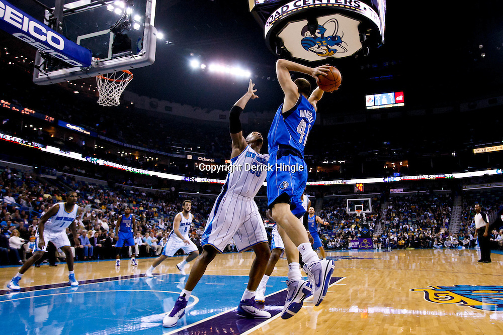November 17, 2010; New Orleans, LA, USA; Dallas Mavericks power forward Dirk Nowitzki (41) of Germany looks to pass as he is defended by New Orleans Hornets power forward David West (30) during the first half at the New Orleans Arena. Mandatory Credit: Derick E. Hingle