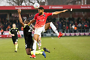 Salford City midfielder Joe Jones fouled by the opponent during the EFL Sky Bet League 2 match between Salford City and Macclesfield Town at the Peninsula Stadium, Salford, United Kingdom on 23 November 2019.